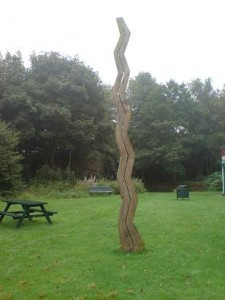 Wavy-line wooden sculpture